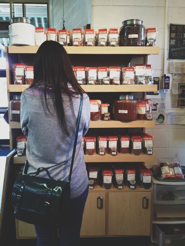 Mary looking at spices